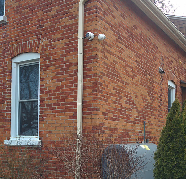 Old home with unobtrusive security camera installation